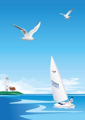 灯台の見える海でヨットを浮かべる