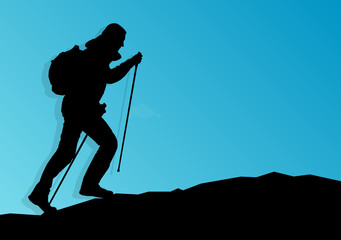 Man hiking in mountains adventure nordic walking with poles in n