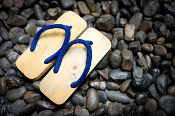 japanese style shoes on the rock. Wood sandals