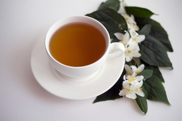 cup of tea and jasmine flowers