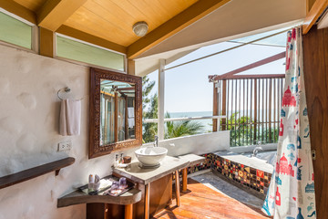 Interior of the modern design bathroom with sea view