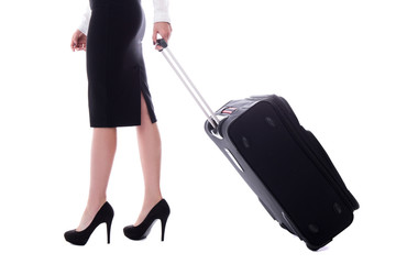 side view of stewardess walking with suitcase isolated on white
