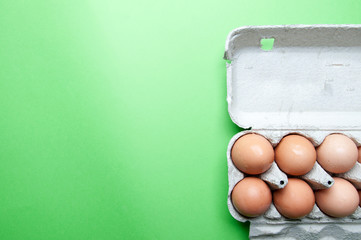 The image of eggs on a green background