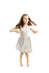 Adorable young girl dancing. Isolated on white background