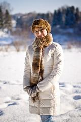 Girl in a coat walks winter day