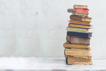 stack of books on white wooden background