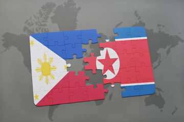 puzzle with the national flag of philippines and north korea on a world map background.