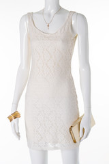 Mannequin in a white openwork lace dress.