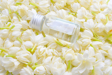 Essential aroma oil with jasmine flower background