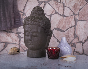Buddha and set of oriental style for spa on the rude stone backg
