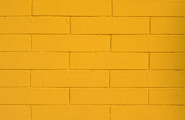 Background of old vintage yellow brick wall
