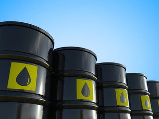 crude oil barrels with yellow label