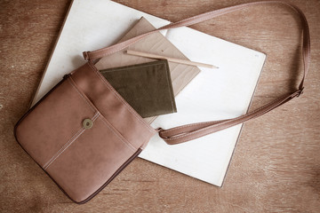 Old Brown Shoulder bag with pocket book , old diary book , old notebook ,and pencil
