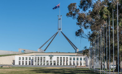 Flag flying over the Australia Parliament Building in the capital of Canberra