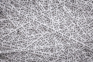 Closeup  tapes of paper with the word NEWS.