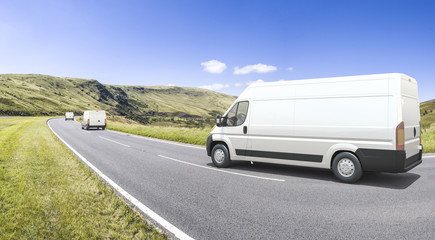 Multiple mini vans in motion on a colorful background
