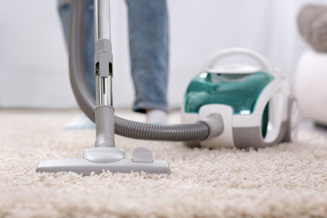 Cleaning carpet with vaccum cleaner