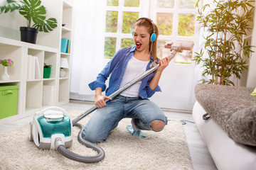 Funny girl with vacuum cleaner