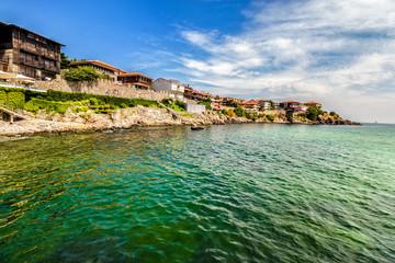 ancient city on a rocky ledge near sea