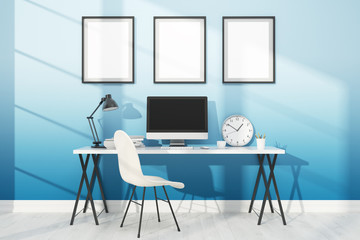Workspace with computer and posters