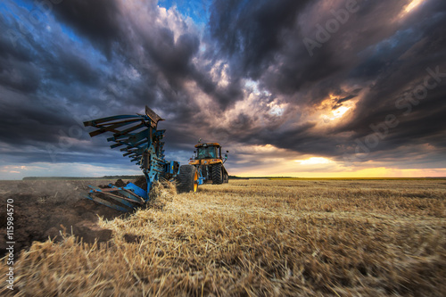 Wall mural Tractor with Plough, Plowing in a Field