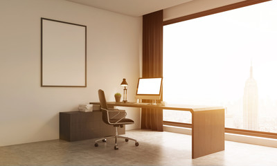 Office room with large window and poster on wall