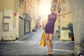 Fashionable woman with yellow bag