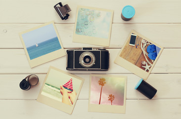 summer travel instant photographs next to old camera