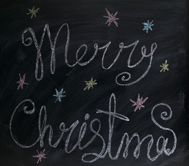 holiday background/ greetings Merry Christmas painted by with chalk on blackboard
