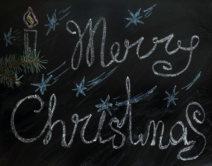 holiday Merry Christmas/ fir branch on a background of a celebratory background drawn with chalk on blackboard