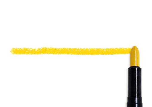 A line is drawn using a yellow lipstick