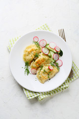 dumplings with potato and salad