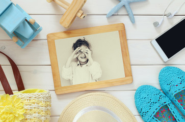 vacation accessories and toys next to cute kid photography