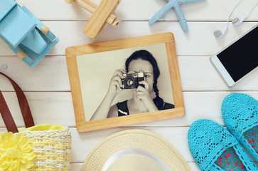 vacation accessories and toys next to young girl photography