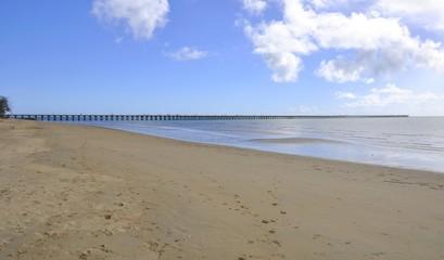 view along the beach  towards the Urangan Pier a historic pier in Urangan, Hervey Bay, Queensland, Australia