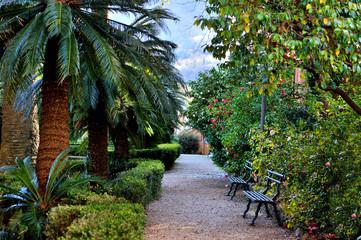 bench in the italian garden-park, overlooking alley