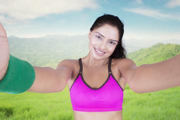 Sporty woman taking a selfie portrait