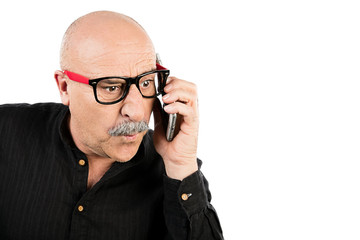 Surprised middle-aged man talking on his mobile