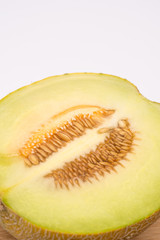 Sliced half melon isolated over white background