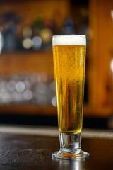 Tall glass of light beer
