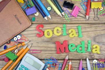 Social Media word and office tools on wooden table