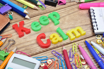 Keep Calm word and office tools on wooden table