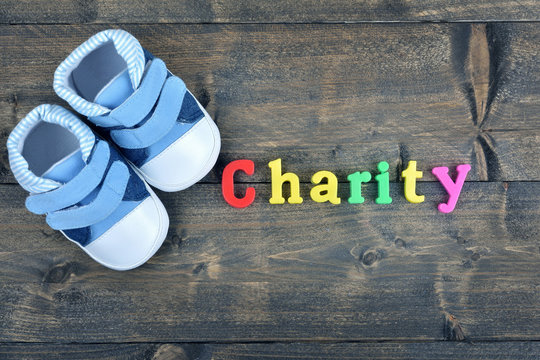 Charity on wooden table