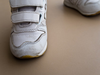 Closeup of children foot walking in sport shoes