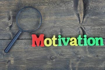 Motivation on wooden table