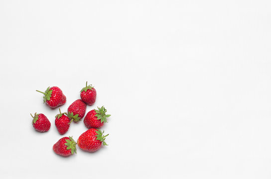 Healthy eating in the restaurant and diet Topic: beautiful ripe strawberries isolated on a white table in the studio top view