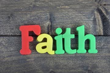 Faith on wooden table