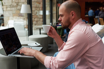 Experienced businessman sitting front laptop computer with blank copy space screen