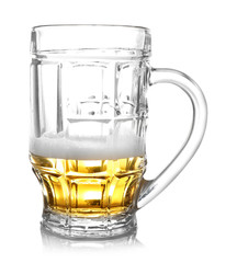 Almost empty beer glass, isolated on white