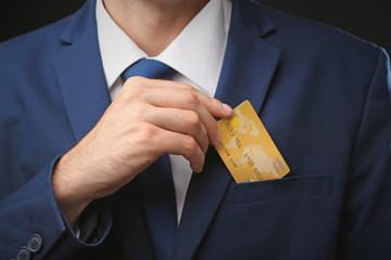 Businessman with credit card, closeup